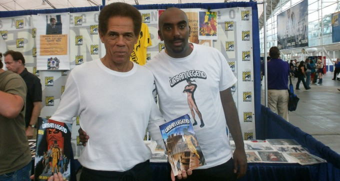 "SUPER HEROES: Yosef John shows his superhero to Jim Kelly from Bruce Lee movie ""Enter the Dragon""."