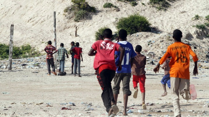 SHOT: Young boys ran to to see blood where Aden Sheikh Abdi was executed Saturday.